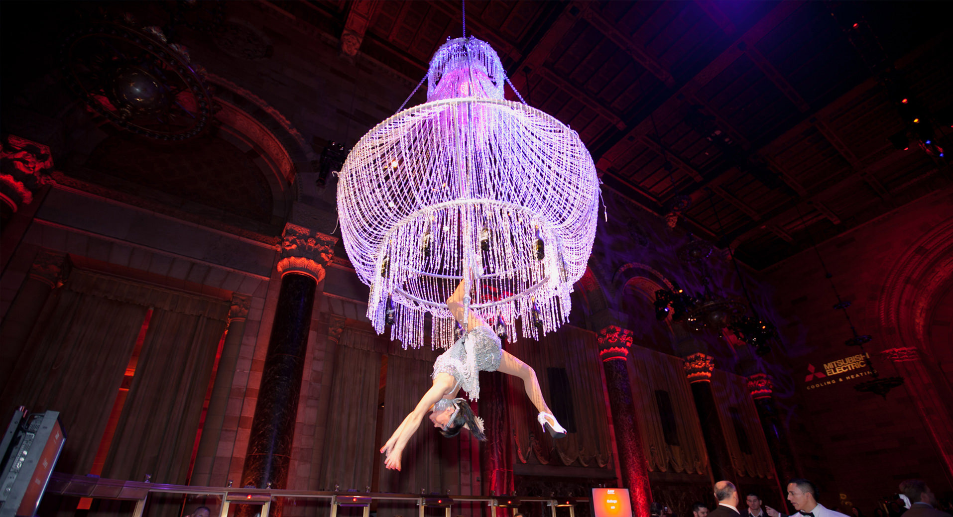 Trapeze artist hanging from a chandellier